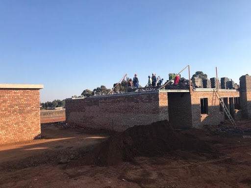 Block 54, with first floor slab and brickwork in progress. Sewage pump house on the left.