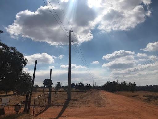 Bulk power line showing a concrete pole with power cables