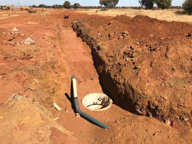 Pic showing water pipeline and sewage manhole. Water line placed at shallow depth above sewers