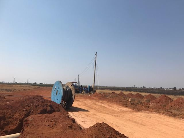Road construction in Ext 7. Last pole with overhead power cables terminating in Ext 7 before going underground