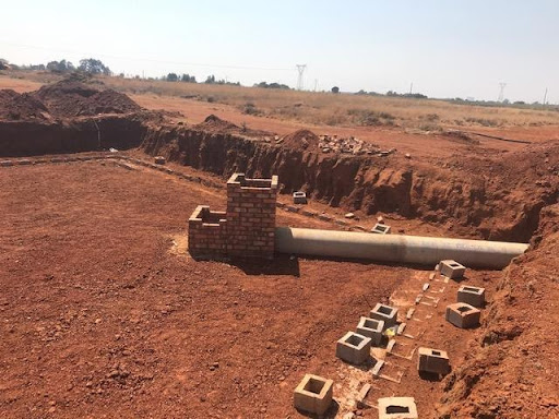 One of attenuation ponds under construction in Ext 6 showing the outlet structure and drain
