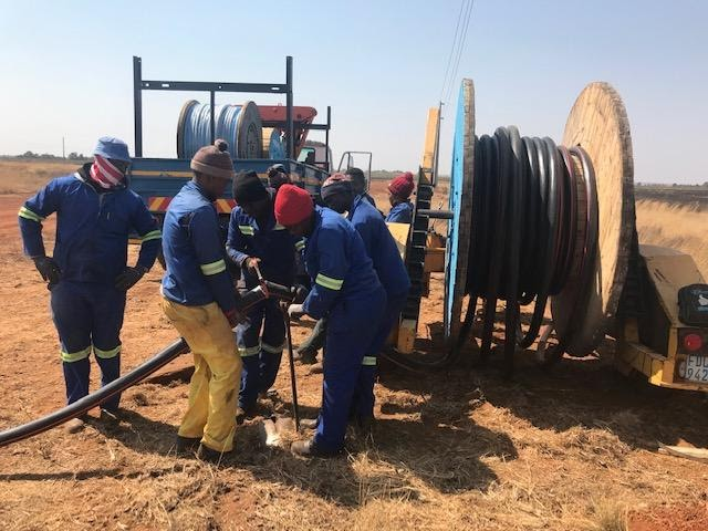 Preparing to place underground power cable into the ground