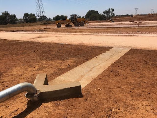 Overflow drain structure finished off, drain now concrete-lined towards the road