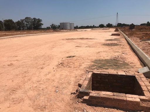 Ext 7 roadway, manholes are for stormwater drainage. To the right are more block platforms