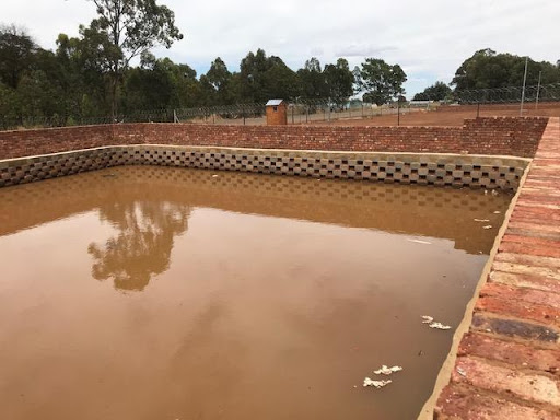 Attenuation pond with lots of water testifying to wet weather experienced on site in the week.