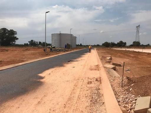 Road in Ext 7 being primed before asphalt paving