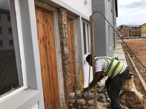 Wall extension to give ground floor neighbors some privacy