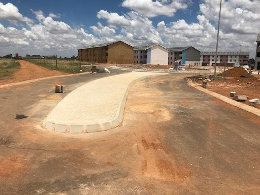 Road linking Ext 5 and 6, showing the main traffic circle and a paved island.
