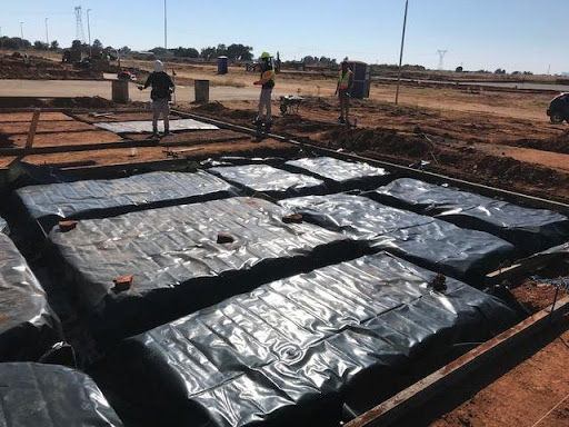 DPC plastic for foundations and concrete beds being placed at B9