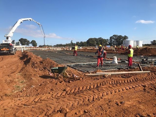 Pouring raft concrete at B4